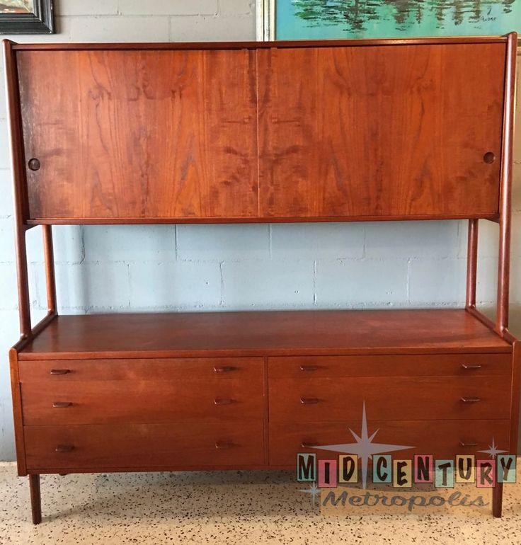 "Made in 1957, this magnificent sideboard with floating hutch was designed by Hans Wegner for Ry Mobler of Denmark. Piece is in stunning original condition. Measures an impressive 71"" wide, it is 21"" deep and it is 70"" tall. 