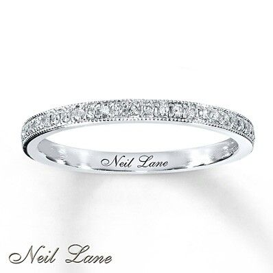 Just doesnt have same wow factor as Tacori version...why? Oh!!! It's the filigree on edge vs plain metal. Like plain metal better. Diamond wedding band, Neil Lane