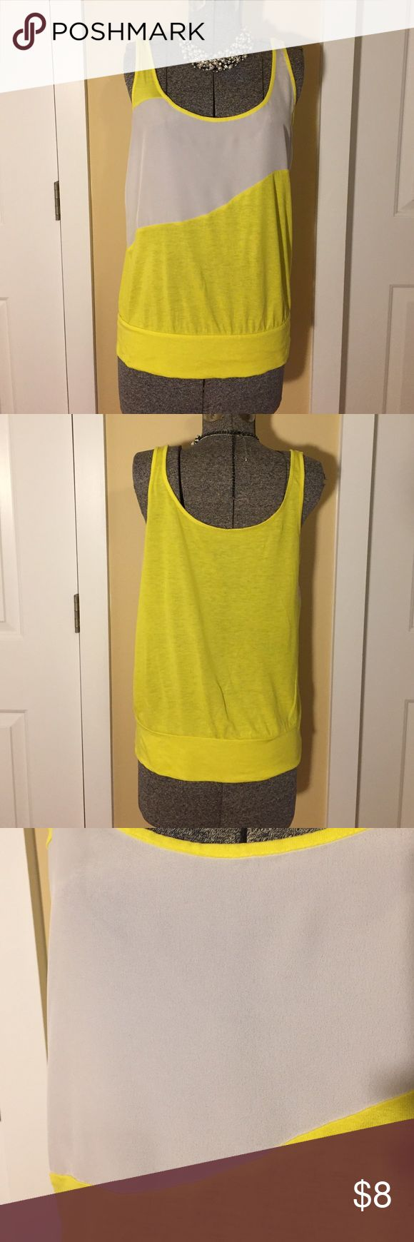 New York & Company tank top New York and Conpany tank top 💛 great condition 💛 size medium 💛 yellow and white 💛 Thank you so much for visiting my page!! I'm currently offering free gift with every $20 you spend.  Be well and spread love. 💛 New York & Company Tops Tank Tops