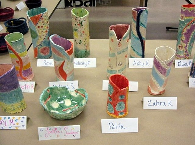 vases and tent cards with names created by the students themselves