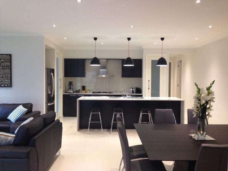 Karen from Sydney shared some photos of her new Manhattan Two home. This is her beautiful living, dining and kitchen area - the true heart of the home. What do you think? #kitchen #dining #living #heartofhome #newhome #blackandwhite #decorate