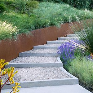 I like this idea - metal border, interesting steps. I think the tiny rocks would be annoying - keeping the stairs clean. Decomposed-granite steps edged with concrete nudge this path upslope in a backyard in Portola Valley, California.