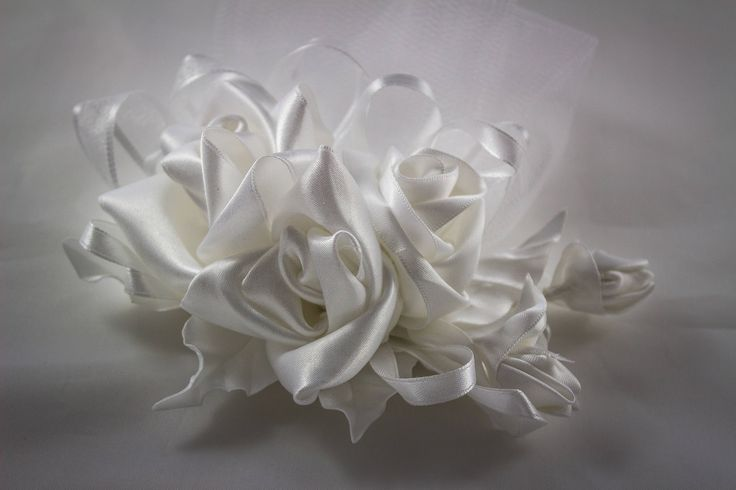 A personal favourite from my Etsy shop https://www.etsy.com/ie/listing/573617275/beautiful-statement-white-kanzashi-satin