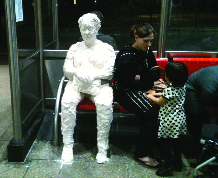 Waiting: life-size plaster sculpture in a bus station