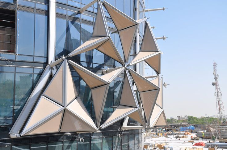 Al Bahar Towers by Aedas in Abu Dhabi is the solar-responsive shading device that are parametrically designed based on the geometric mosaics of the 'mashrabiya' – traditional wood lattice screens prevalent Arabic architecture.