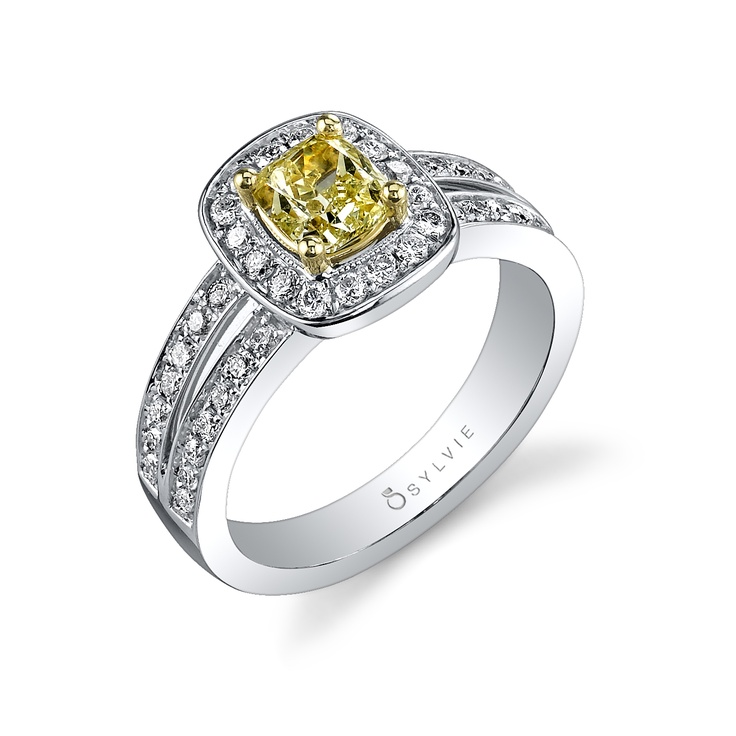 Fancy yellow diamond engagement rings are gaining popularity thanks to celebrities like Carrie Underwood. But you don't need a Hollywood bank account to afford one! This exquisite Sylvie ring contains a 0.75-carat cushion-cut fancy yellow diamond surrounded by glittering pave halo and double shank. More affordable and just as beautiful!