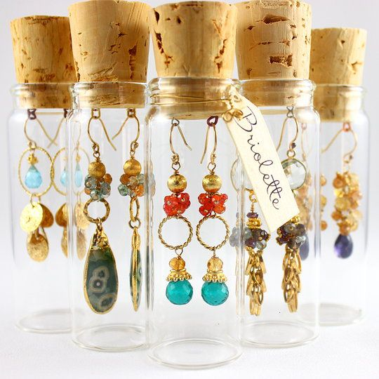 Earrings packaged in corked vials