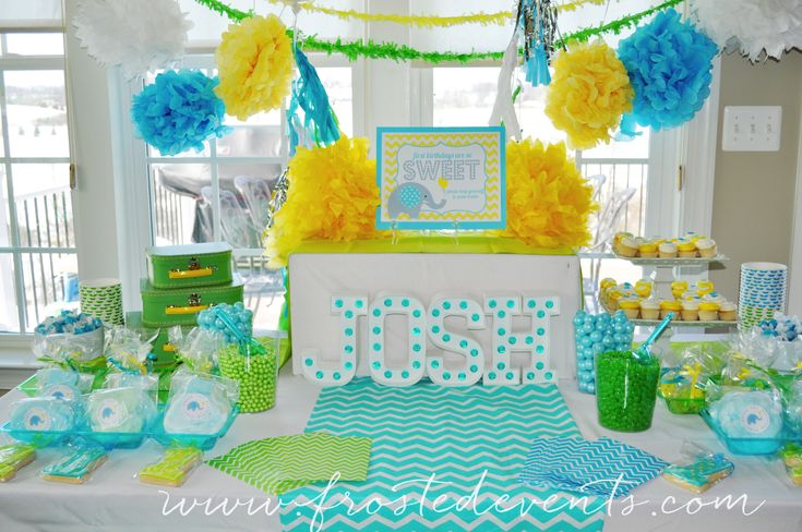 Dessert Table A Bright and Fun First Birthday!  Frosted Events--  The cutest little boy birthday party in aqua blue, yellow and green.  Chevron and dot patterns, a gorgeous dessert table, cute elephant party hat and party favors, elephant decorated cookies and cupcakes, a popcorn bar and lots more!   #firstbirthday #boysfirstbirthday #babyelephant #blueandgreen #blueandyellow #kidsparty #desserttable