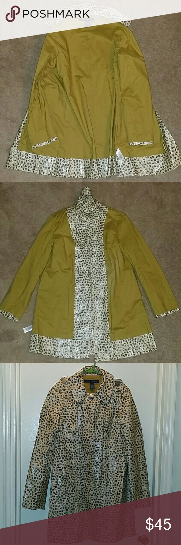 French Connection Flower Print Rain Coat Small print flowers on a deep yellowish cream base rain jacket. Gorgeous contrast mustard lining, large round silver buttons. Tab button detail on shoulder. Hidden buttons down front except first top one. Coat hits knee leghth. Slight A line shape. New, never worn, without tags. French Connection Jackets & Coats Trench Coats