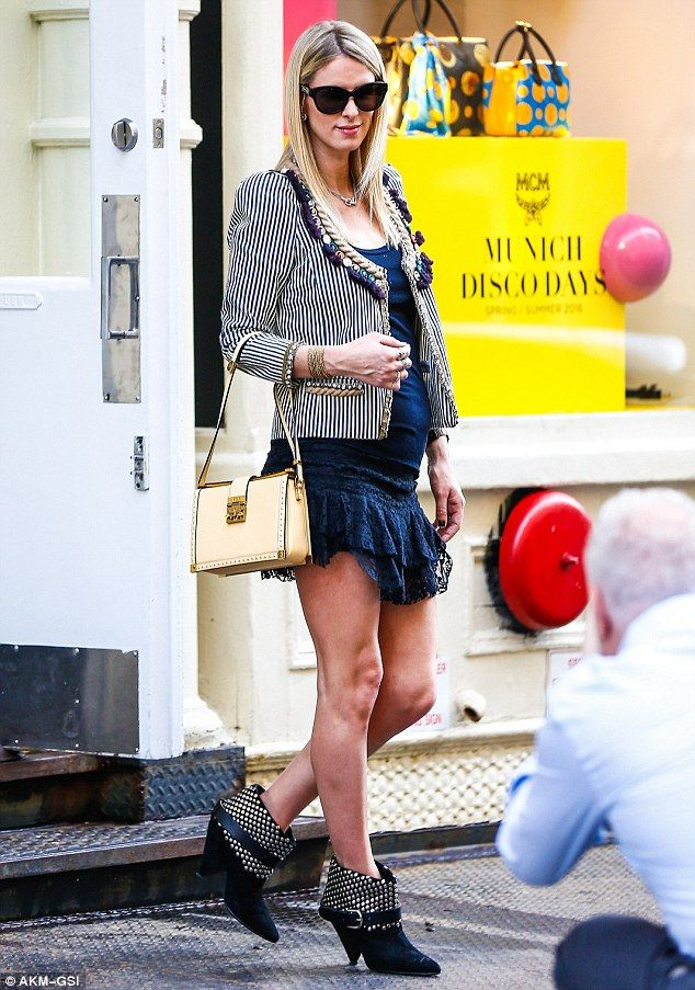 Blooming! Nicky Hilton, 32, showed off her tiny baby bump in New York City on Wednesday...