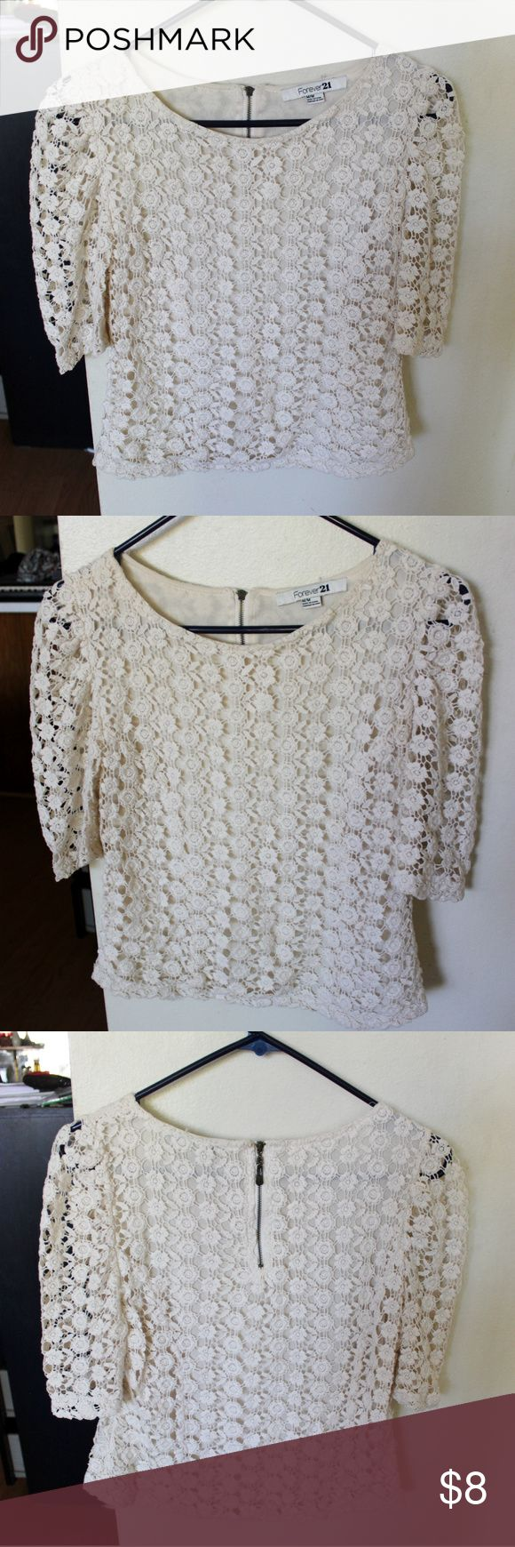 """Forever 21 Cream Floral Crochet Short Sleeve Top A cute Forever 21 cream crochet blouse in a size medium. Is lined underneath except on the sleeves and has an all-over floral crochet design. Is slightly see-through. Fits slightly cropped, about hip length. Armpit to armpit: 16.5"""", length: 19"""". Forever 21 Tops Blouses"""