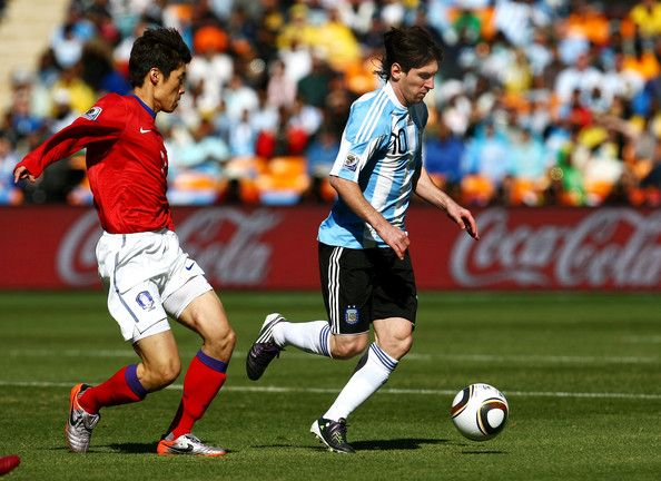 Park Ji-sung Photos - Lionel Messi of Argentina is pursued by Park Ji-Sung of South Korea during the 2010 FIFA World Cup South Africa Group B match between Argentina and South Korea at Soccer City Stadium on June 17, 2010 in Johannesburg, South Africa. - Park Ji-sung Photos - 153 of 225