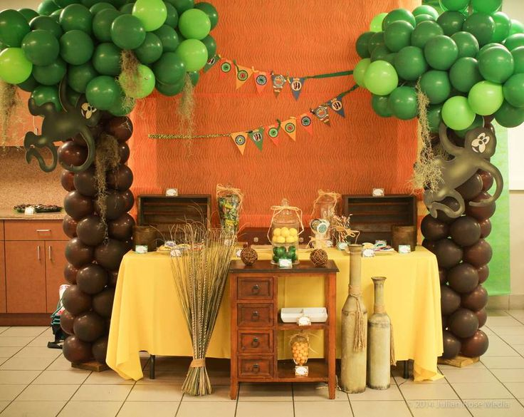 Jungle birthday party dessert table and backdrop!  See more party planning ideas at CatchMyParty.com!