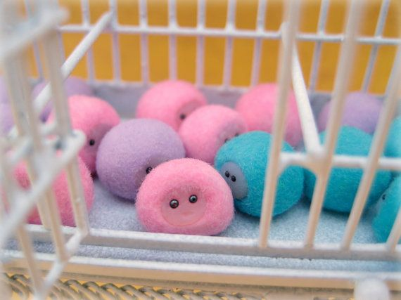 Pygmy Puffs in dollhouse miniature: Super cute, pink, and ready to be adopted (from the world of Harry Potter).