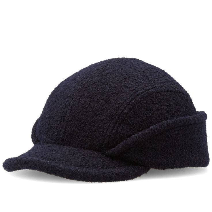 Made entirely in France, Arpenteur modernises French work clothing from the 30s, 40s and 50s into a modern laid-back style, with each silhouette constructed from a fabric that simultaneously wearable, sturdy and timeless. The Cahors Cap comes expertly manufactured from a specialist factory that has been in operation since the '40s, comprised of an unlined boiled wool fabric with versatile flaps that can be folded over for ear protection in cold and inclement weather.   100% Wool  Grey…