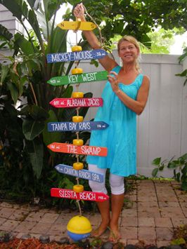 Hanging style mile marker includes your own Personalized Mile Markers strung on a poly-rope with yellow net buoys used as spacers. Each Mile Marker is topped with a directional sign and anchored with