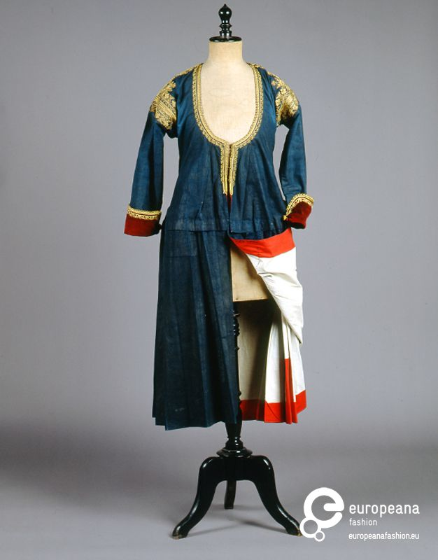 "Coatdress Megara, Greece ""Kaplamas"". The everyday indigo dyed coat dress of Megara, a village northwest of Athens, lined with white and red cotton lining, when worn, was often pulled at the back. Late 19th c."