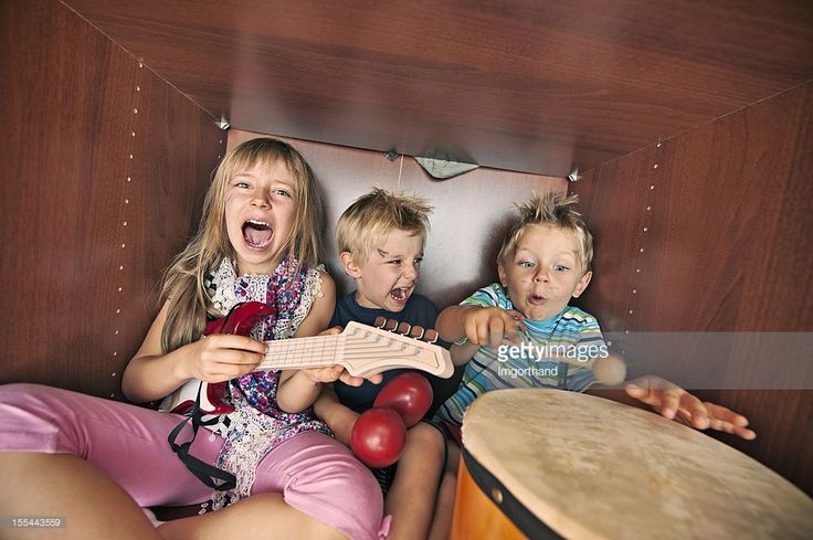 Kids band playing music and singing inside wardrobe. Actually ... kids making noise and screaming inside wardrobe after throwing all mum's clothes all over the room .....