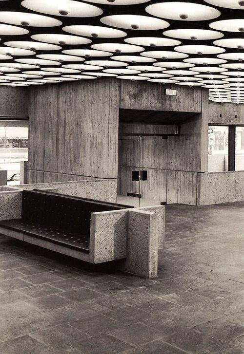 Whitney Museum Lobby. Concrete.  Lighting- half-chrome lightbulbs with diffuser shades.