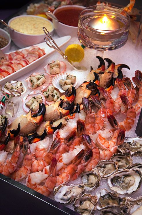 Wedding appetizer idea: Love seafood! A melange of complimentary dipping sauces accompany fresh peeled shrimp and seasonal stone crab legs.
