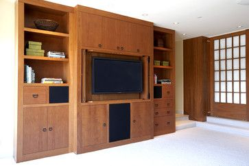 Asian influenced wall unit provides lots of closed storage with a few open shelves for display.