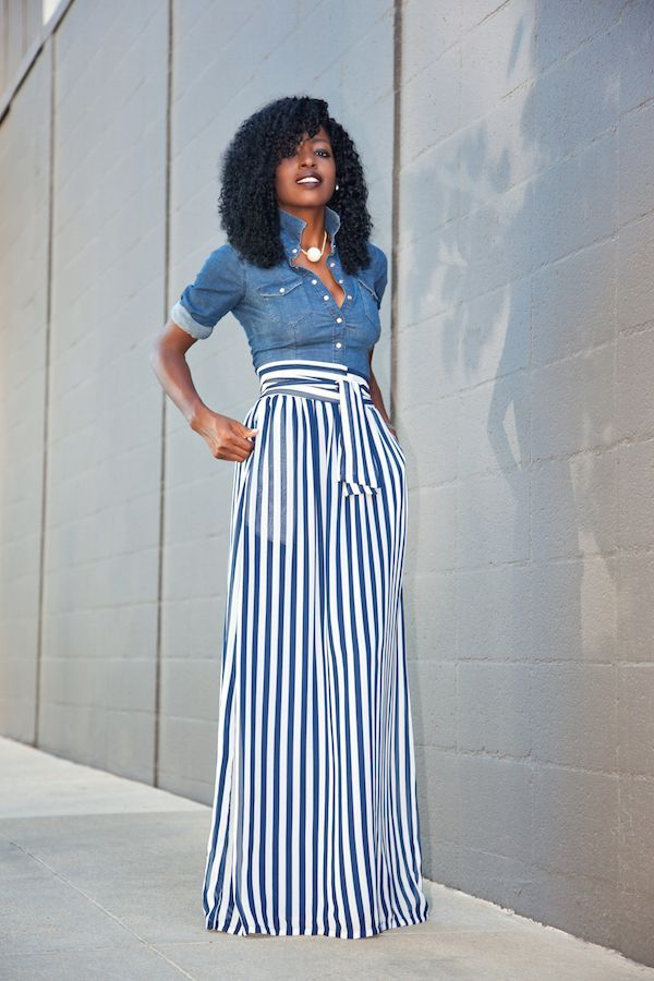 Mother of the bride: blue and white striped shirt, white skirt, pearls, stand up collar, and buttoned up