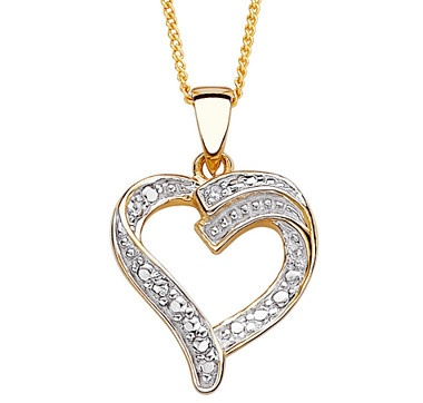 A genuine Diamond accent dazzles from this two-tone heart pendant crafted of Sterling Silver layered in 14K Gold and Rhodium.