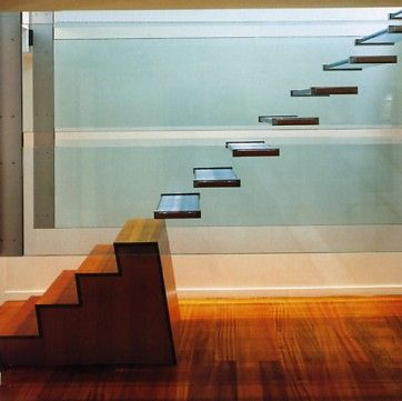 great use of glass and wooden block. take away the wooden block to stop the kids climbing up the stairs perhaps..??