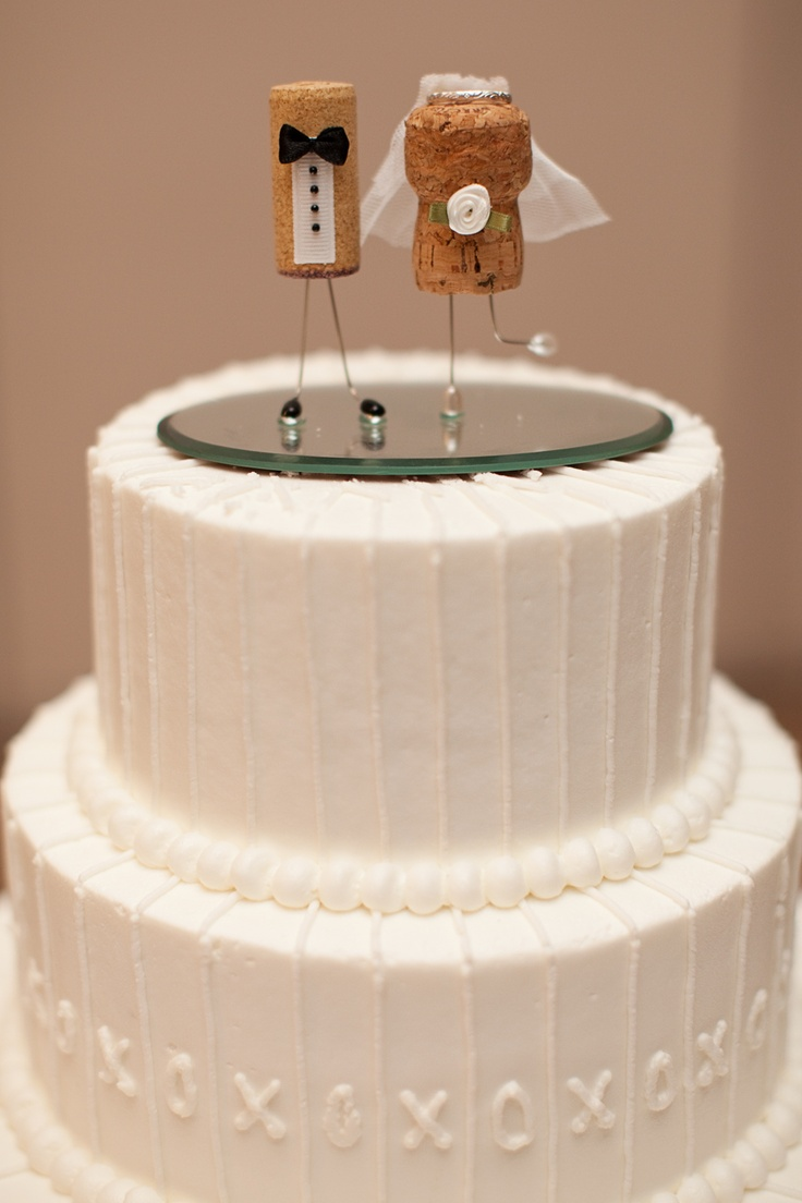 Our fabulous cake topper! Couldn't find one we liked, so we got creative with a wine & champagne cork which was actually completely perfect. (Credit to @Adrienne Bourgeois for being so awesome with ribbon & hot glue guns!)