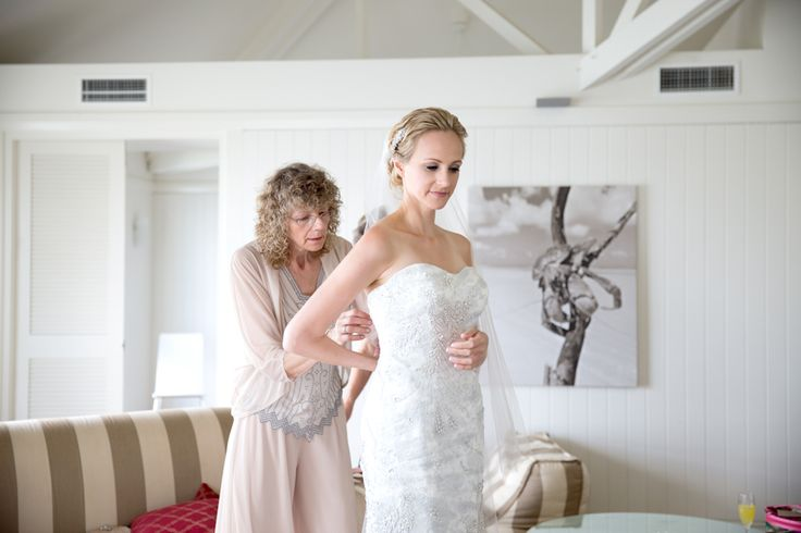 Brides mother lacing up dress, Novotel Twin Waters Resort. www.lanicarter.com