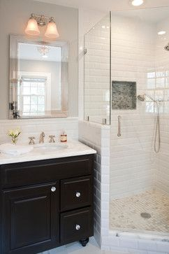 White Subway Tile Shower -- pretty and beveled. Also like dark vanity with light top and interesting shower floor tile (don't like niche tile)