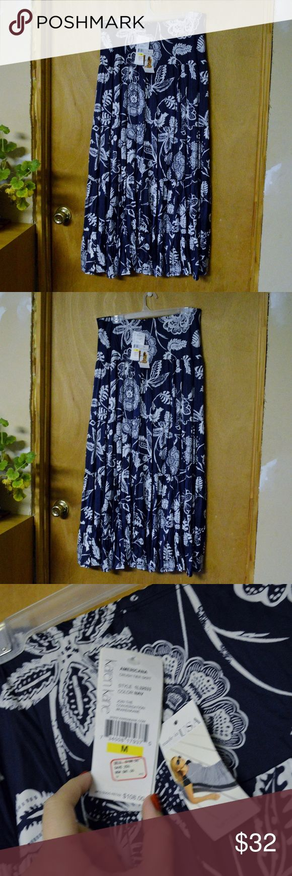 """NWT Karen Kane Americana Crush Tier Skirt Size M Up for sale is one skirt, as pictured, by Karen Kane. It is NWT and in excellent condition. It is navy and white, and the style is called Americana, Crush Tier Skirt. It features a top skirt and bottom, one polyester and the other nylon. The top/tiered portion is long (I'm 5'10"""", and it goes to my ankles), and the lining/slip layer is much short (about to my knees). This gives it an airy, flowy feel.  the tags are wrinkled from storage…"""
