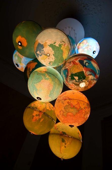 'Monde à l'endroit, Monde à l'envers' by Benoit Vieubled. 2m high chandelier made from 15 recycled world globes.