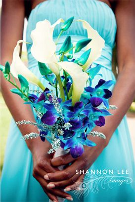 A: Beautiful wedding bouquet with blue dendrobium orchids and lilies. Maybe for the bridesmaids? Something similar for the bridesmaids?