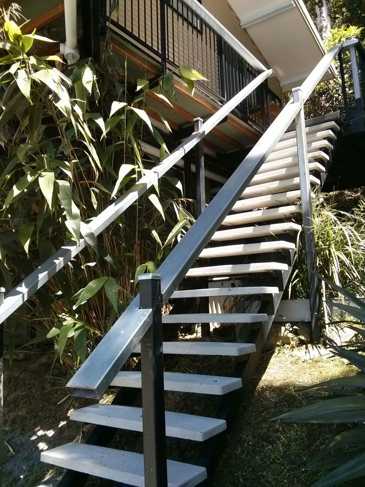 External stair rail with concrete treads