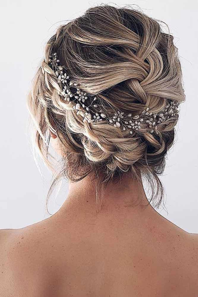 This is honestly one of my favorite wedding hairstyles lined with a jewled hair belt while in a braid that's stunning
