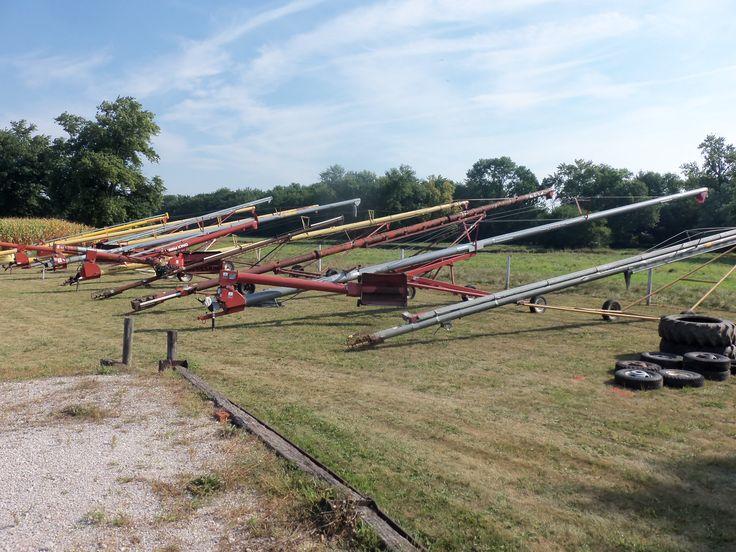 Lineup of  9 grain augers