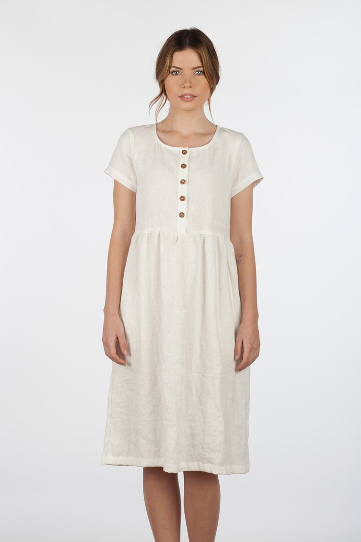 MODEL No. 11 Cloud white Linen dress in a midi length with short sleeves, fully functioning wooden buttons and pockets. Please note that this is a medium/heavier weight linen, and quite an opaque white linen, but I do recommend nude color underwear! Designed and ethically made in California with fin
