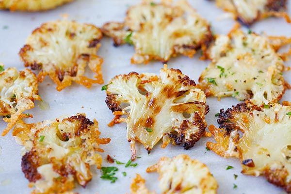 Parmesan Roasted Cauliflower | roast at 400° F = 200 C Toss the sliced cauliflower with the butter and olive oil. Season with salt and black pepper. roast until almost tender about 20-30 minutes, sprinkle the grated Parmesan and chopped parsley, roast again until the cheese melts and slightly crusty, about 5 minutes. serve immediately.