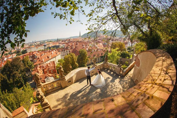 a couple from Hong Kong have a dance overlooking Prague at one of Prague's Castle gardens www.KurtVinion.com
