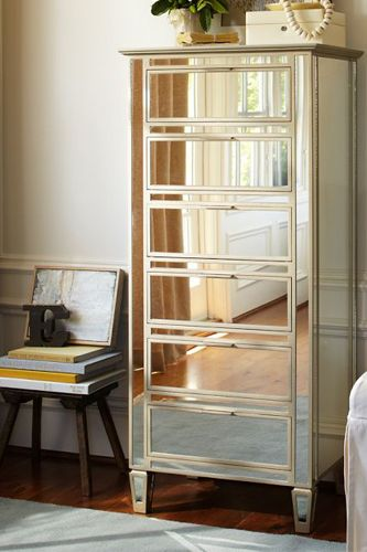 vertical dressers make use of vertical space.  mirrors reflect light making the space appear larger (plus they are so glamorous and go with everything)