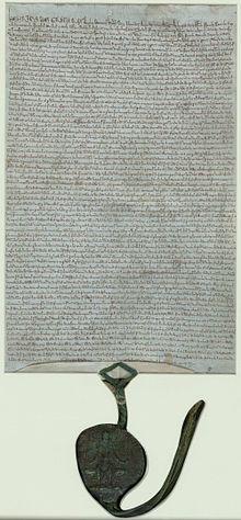Un des quatre exemplaires restant de la Magna Carta de 1225, conservé à l'abbaye de Lacock et déposé depuis 1945 à la Bibliothèque britannique.