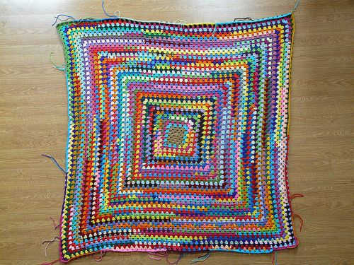 Great idea: use yarn scraps to make a giant granny square afghan