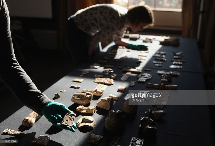 A technician at the British Museum holds a piece of carved ivory from ancient Assyria recently acquired by the British Museum on March 7, 2011 in London, England. The 6000 carved, decorated pieces known as the Nimrud Ivories date from the 9th to 7th Century BC and were made near the Mediterranean coast. They were discovered in the city of Nimrud in modern day Iraq and excavated by the British Institute for Study of Iraq between 1949 and 1963.