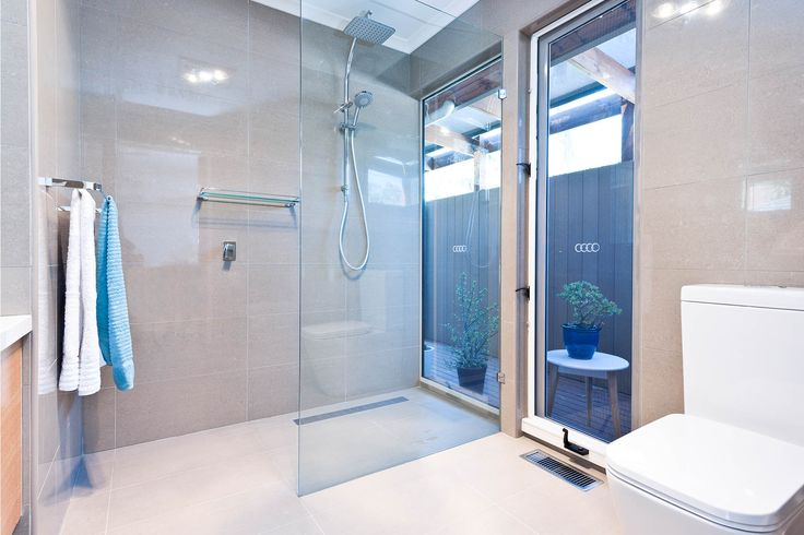 Renovated guest bathroom. Both the en-suite and guest bathrooms were completely gutted in order to re-configure the space and layout.