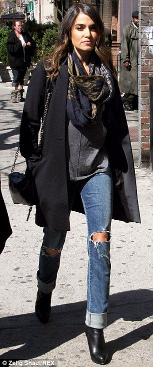 Style range: Nikki showed she could go stylishly casual earlier on Thursday in ripped jeans