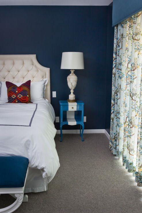 peacock blue walls  grey carpet  ivory headboard