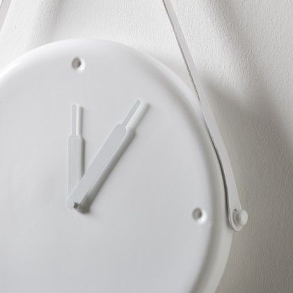 Horamur wall clock by Spanish designer Jaime Hayon for Bosa. This elegant piece is made in white leather and ceramic. http://www.wannekes.com/modern-design-clocks/1107-horamur-wall-clock-jaime-hayon.html.