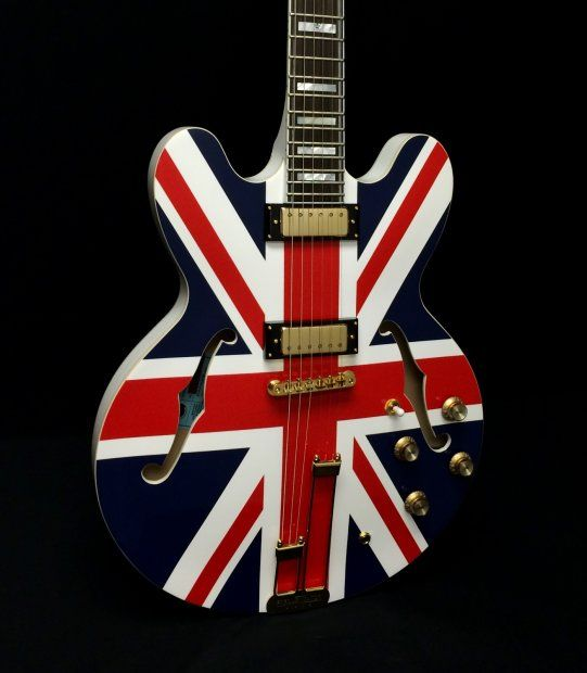"Epiphone Union Jack Sheraton Semi-Hollowbody Electric Guitar Product Description:The Epiphone Limited Edition ""Union Jack"" Sheraton Hollowbody Electric Guitar comes equipped with premium electronics including Epiphone mini-Humbuckers, CTS potentiometers and Grover 18:1 ratio machine heads. It displays an amazing attention to detail with its 1996 USA Sheraton headstock shape and vine inlay; additional fretboard inlays at the 17th, 19th and 21st frets; blank truss rod cover; ..."