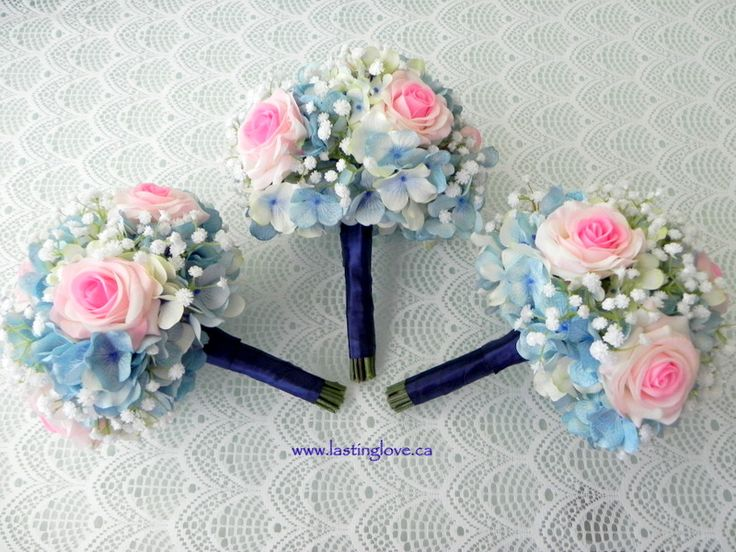 Blue silk hydrangea, real touch pink roses and real touch baby's breath make up these soft wedding bouquets. #hydrangeaweddingbouqets #pinkroses #baby'sbreathbouquets